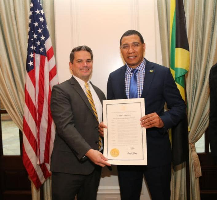 Mr. Daryl Moody who represented the Governor presenting the proclamation to Prime Minister Andrew Holness