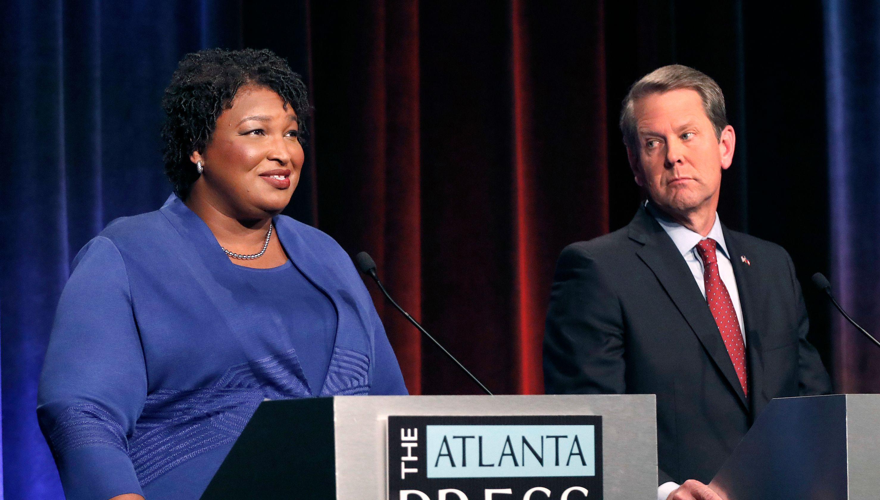 Tuesday, Oct. 23, 2018 file photo, Democratic gubernatorial candidate for Georgia Stacey Abrams, left, speaks as her Republican opponent Secretary of State Brian Kemp looks on during a debate in Atlanta. (Photo: John Bazemore, AP)