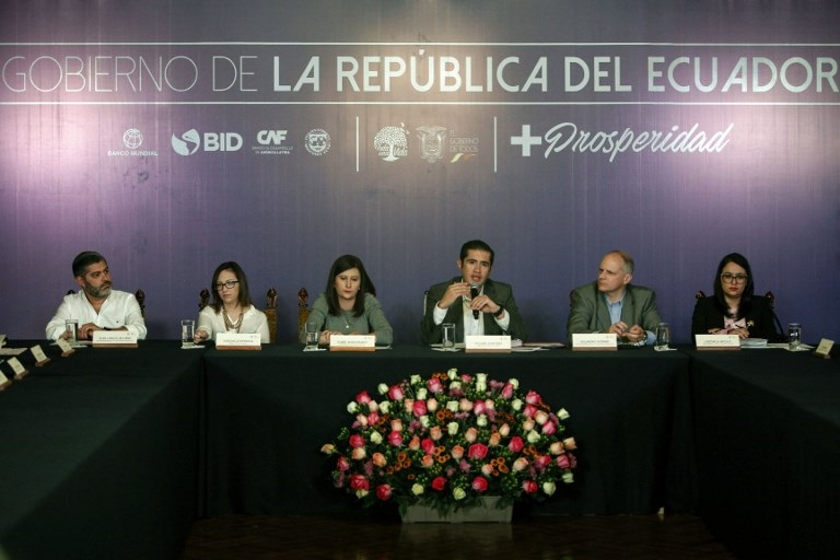 Ecuador's Economy Minister Richard Martinez (C) offers a press conference, along with other government representatives, on the 10 billion dollars financial aid the country will receive from global development bodies at the Carondelet palace in Quito on February 21, 2019. - The IMF said a staff-level agreement had been reached with Quito for $4.2 billion in loans, with the remainder coming from the Development Bank of Latin America, the Inter-American Development Bank, the World Bank and the Latin American Reserve Fund. (Photo by Cristina VEGA / AFP)
