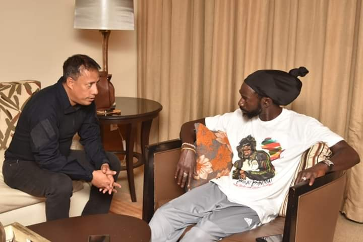 Trinidad's police commissioner Gary Griffith speaking with Buju Banton in his hotel room. Ent Breaking News Photo