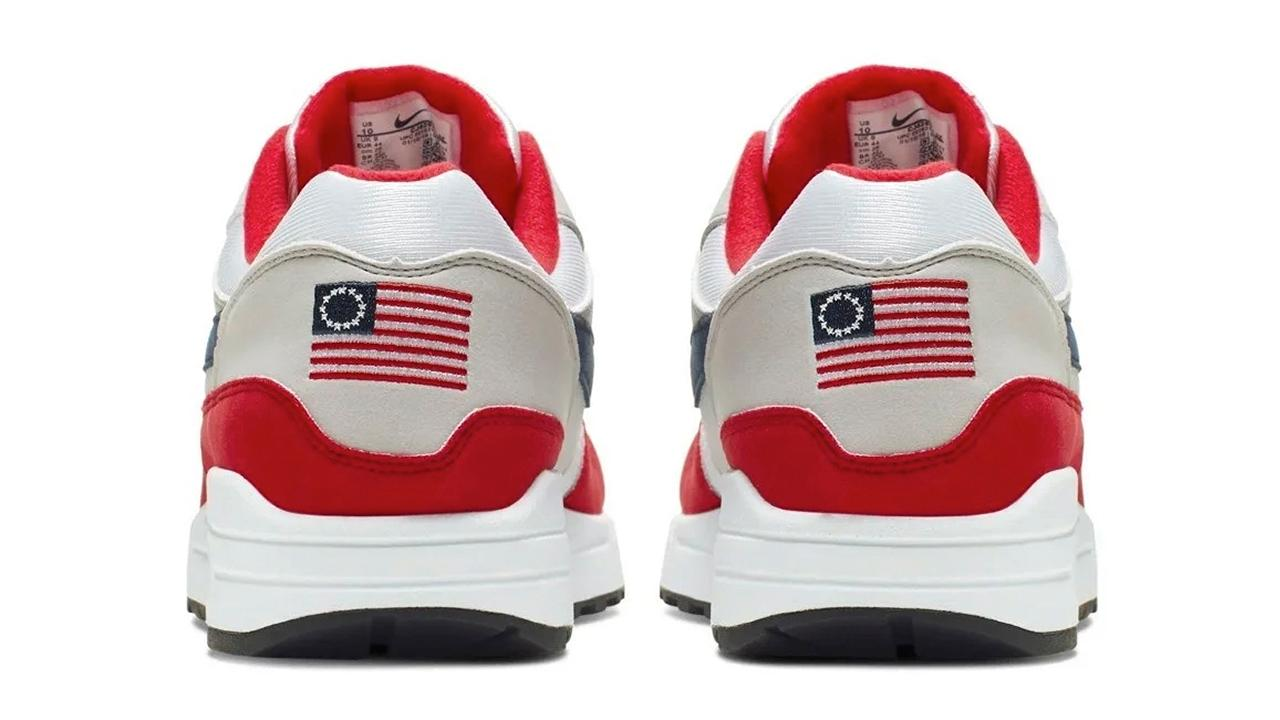 The shoes, which featured the American flag designed by Betsy Ross that has 13 stripes and 13 stars to represent the original US colonies.