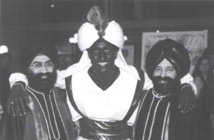 Trudeau, sandwiched between what appears to be two Sikh men was uncovered from the schools website archives.