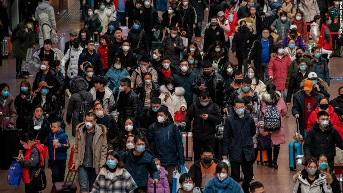 Chinese Travelers Wear Mask to Protect Against Virus