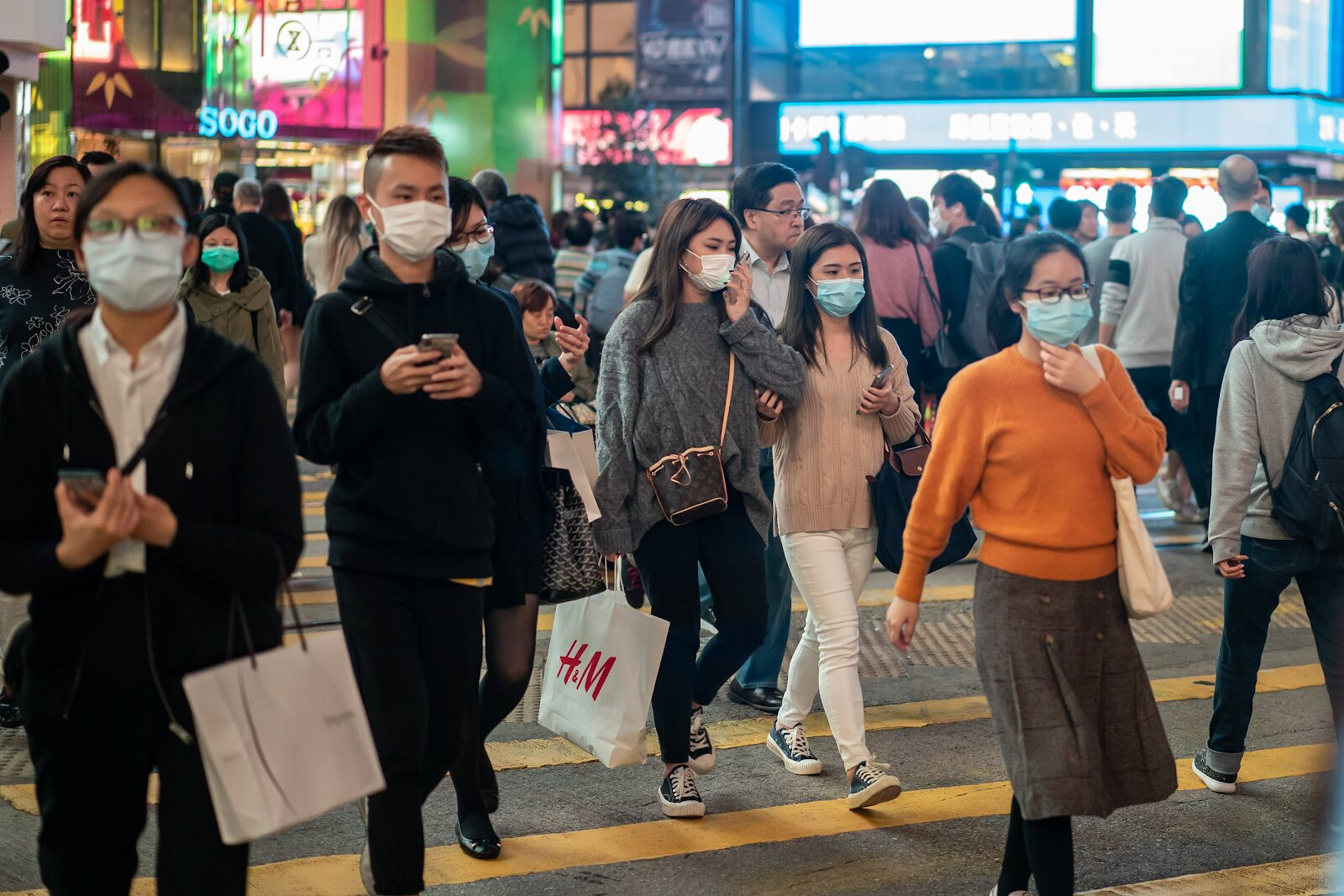 Pedestrians wear face masks as they walk through a crosswalk in Causeway Bay on January 23, 2020 in Hong Kong. Anthony Kwan/Getty Images (from a CNN article)