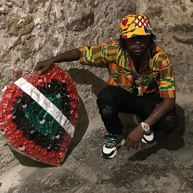 Dancehall artist #Popcaan pays respect to his ancestors by laying a wreath.