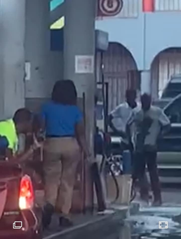 Gas Station Attendant standing in oozing out on the ground