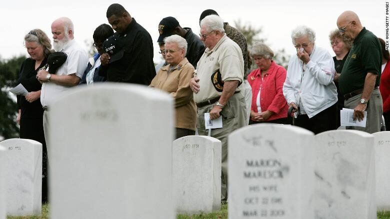 Family members of victims of the USS Cole attack attend a ceremony at the Arlington National Cemetery