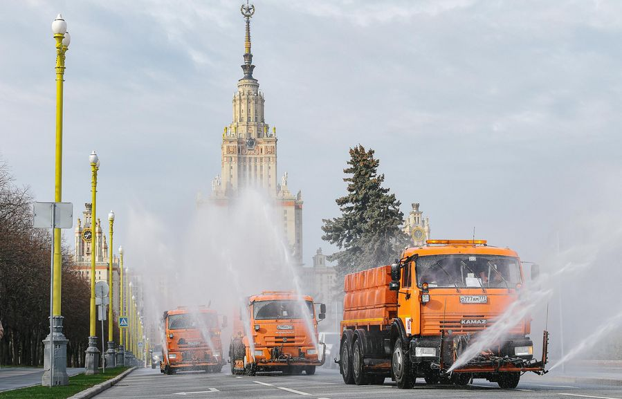 Utility service vehicles disinfect a road in Moscow, Russia, on April 24, 2020. (Xinhua/Evgeny Sinitsyn)