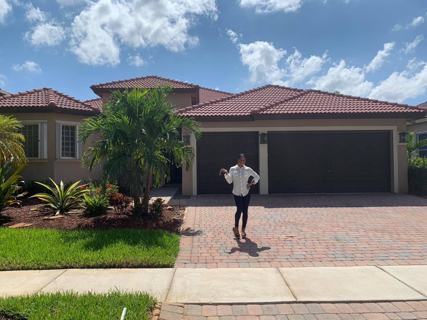 Briana Williams in front of her new home in Florida