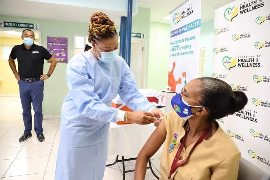 Public Health Nurse Mrs. Marcia Thomas Yettman getting the shot